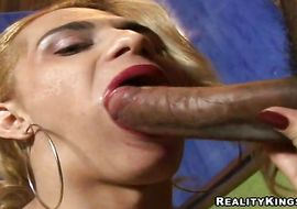 Worshipped blonde trannie Beatriiz is getting stuffed with huge tool in da booty while rubbing his balls